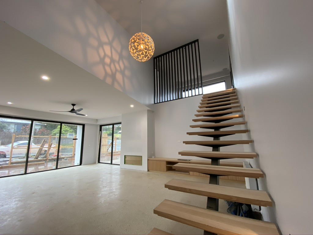 Large lighting fixture above staircase